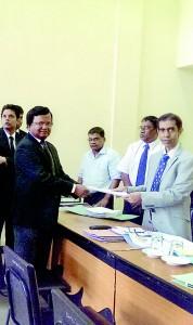 BASL President Upul Jayasuriya (L) hands over his nomination papers to Returning officer Solicitor General Yuvanjan Wijeyatilake
