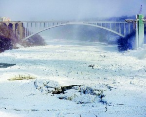 In the incredible pictures, the Rainbow Bridge is seen with solid ice below it. Reuters