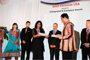 Thahani receiving her award