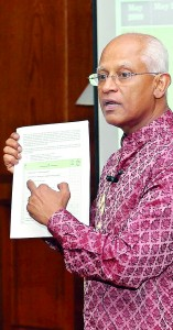 Mr. Weeratunga makes a point to journalists