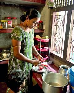 Bamini prepares a Jaffna dish in her kitchen