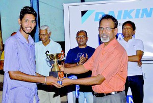 Daily Mirror skipper Supun Dias receives the runner up trophy from Lal Jayawardena, Director WNL