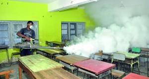A CMC worker fumigating a classroom. Pix by Indika Handuwala