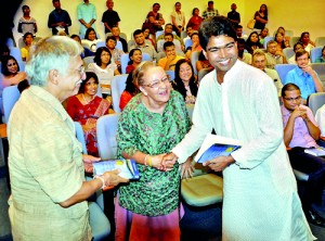 The 2012 Gratiaen Award winning novel 'Playing Pillow Politics at MGK' by Lal Medawattegedara was launched in November at the Lakshman Kadirgamar Institute for International Relations & Strategic Studies. Here the author presents a book to the US writers Ken and Visakha Kawasaki who were the language editors of the book. Pix By Mangala Weerasekera