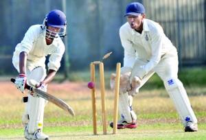 Wesley's Kavindu Bandaratilleke is bowled by Royal's Devin Pathmanathan