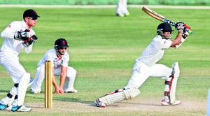 Sri Lanka 'A' top scorer Madawa Warnapura drives against England Lions at Pallekelle yesterday. - Pic Shantha Ratnayake