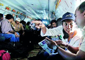 On war coverage: Mel Gunasekera together with her journalist colleagues flying to the war zone during the height of the Sri Lanka's civil war. AFP Photo/Ishara Kodikara