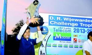 The winning captain Vijaya Wagarachchi with the D.R. Wijewardena Challenge Trophy