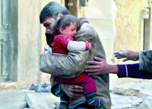 A boy holds his baby sister saved from under rubble, who survived what activists say was an airstrike by forces loyal to Syrian President Bashar al-Assad in Masaken Hanano in Aleppo February 14 (REUTERS)