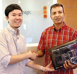 Blackmagic Asia Marketing Manager Gregory Chang handed over new camera to Rohan Welivita in Singapore