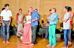To Vajira with love: Arun Abeyagunawardena makes a donation to the CV Dance Company watched by family members