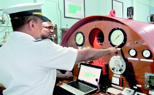 Under the watch of Navy doctors, Navy divers undergoing  treatment inside Recompression Chamber