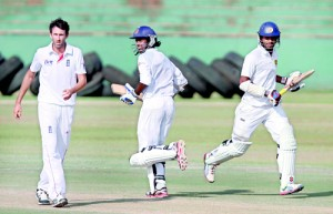 Openers Upul Tharanga and Dimuth Karunaratne transferred the frustration on to England Lions with a stand of 228 runs on the final day at Dambulla - Pic by Shantha Ratnayaka