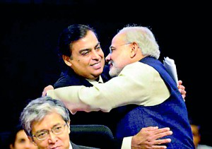 Narendra Modi greets Chairman and Managing Director, Reliance Industries Ltd. Mukesh Ambani on the launch of Vibrant Gujarat in 2013 (AFP)