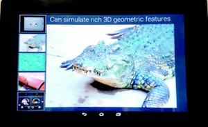 Virtual reality touchscreen: Japanese firm Fujitsu has developed a prototype tablet device that uses ultrasound vibrations to mimic a variety of textures, such an alligator's skin (pictured)