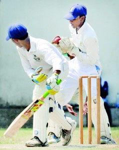 DSS batsman Akil Imran is caught by Dharmaraja wicketkeeper Kavinda Ratnayake off  Dinesh Lanka. Pix by Ranjith Perera