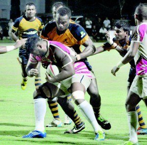 A Havelocks player tries to barge through an Army defender.  Pic by Ranjith Perera