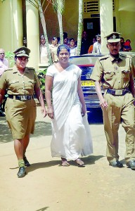 A school principal being brought to court in Matale. She is charged with soliciting bribe to admit a child to Grade 1. Pic by Mahesh Keerthirathna