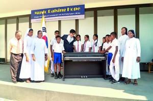 P&E- Piano donation pic