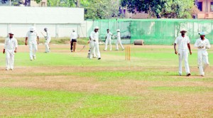 Action at the Sri Lanka Ports Authority XI vs Ragama CC Premier Division match at the Moors grounds, yesterday. Both these teams have no home ground of their own and more or less are run by individuals or a few devoted fans. (Pic. Ranjith Perera)