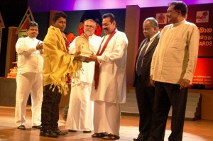 Picture shows the President handing over one of the awards.