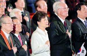 South Korea's President Park Geun-hye (C) salutes the national flag during a ceremony celebrating the 95th anniversary of the March First Independence Movement against Japanese colonial rule, in Seoul (AFP)