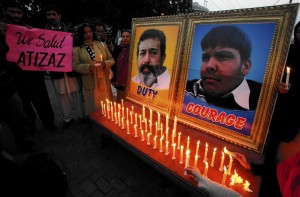 A vigil in Pakistan honours Aitzaz Hassan (photo on right), who was killed Jan. 6 after tackling a suicide bomber who was about to enter his school. The other photo shows Pakistani policeman Superintendent Chaudhry Aslam, who was killed in a separate bomb attack in January (REUTERS)