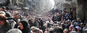 Syria's starving population: Hundreds of men, women and children gathered amid the rubble of Damascus for UN food hand-outs after being cut off for months. The United Nations Relief and Works Agency (UNRWA) called on rebel forces and Assad's troops alike to allow 'safe and unhindered humanitarian access' to civilians in Yarmouk, a Palestinian district in the Syrian capital ( Reuters)