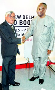 Vijitha Yapa,  new Chairman of the Afro Asian Book Council being congratulated by the former Chairman Dayo Alabi who is the Chairman of The Book Company Ltd of Lagos, Nigeria.