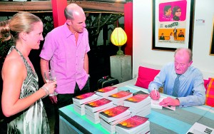 Julian Beale signs books for guests. Pix by  Mangala Weerasekera