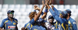 Sri Lanka's fielders celebrate with teammate Lasith Malinga as he dismissed Pakistan's Ahmed Shehzad during their 2014 Asia Cup final match in Dhaka on March 8, 2014. However, would they come down from their stance on the Guarantee money standoff with the SLC. - AFP