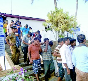 A boat-load of illegal immigarnts to New Zealand apprehended last month in Beruwala. Pic by Sarath Siriwardhena