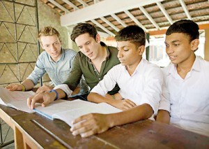 Rob and Paul Forkan with youngsters in Sri Lanka. Pix courtesy Lee Thomson and Annie Oswald