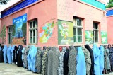 Afghans hail peaceful election; high turnout