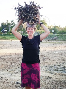 Sandy helps a woman by carrying her firewood at Kirinda