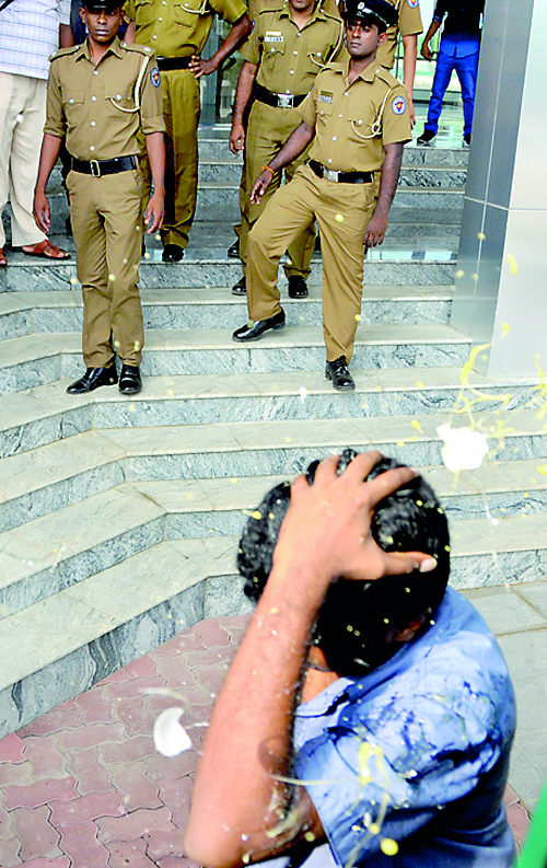 Coming under an egg attack as police look on during the recent Hambantota incident