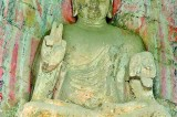 Ancient Buddha statue raises two fingers just like modern day anti-war sign