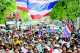 Thailand's 'Red Shirts' rally to defend wounded government