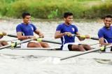 Navy men and Army women row through