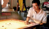 Youngsters struggle against experienced carrom players