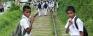Schoolchildren's lives at risk walking on railtracks