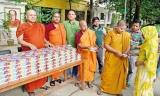 Bangladeshi Buddhist monks feed fasting Muslims over Ramadan