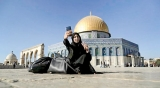 Palestinians connect to Jerusalem's Muslim holy sites with selfies