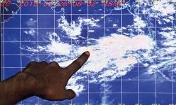Landslide death toll rises; more warnings