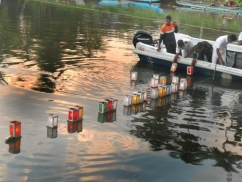 Floating lanterns: Tsunami memorial at sea