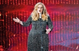 Adele's latest album  continues top US charts
