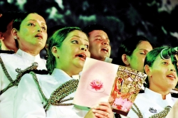 Police sing for the thrice-blessed day of Vesak