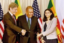 Diplomatic smiles but no cross handshake