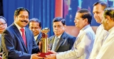 Commercial Bank honoured with Gold award by ETF
