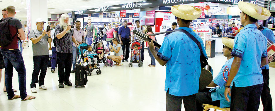 Passengers  hang around at  airport and face the music
